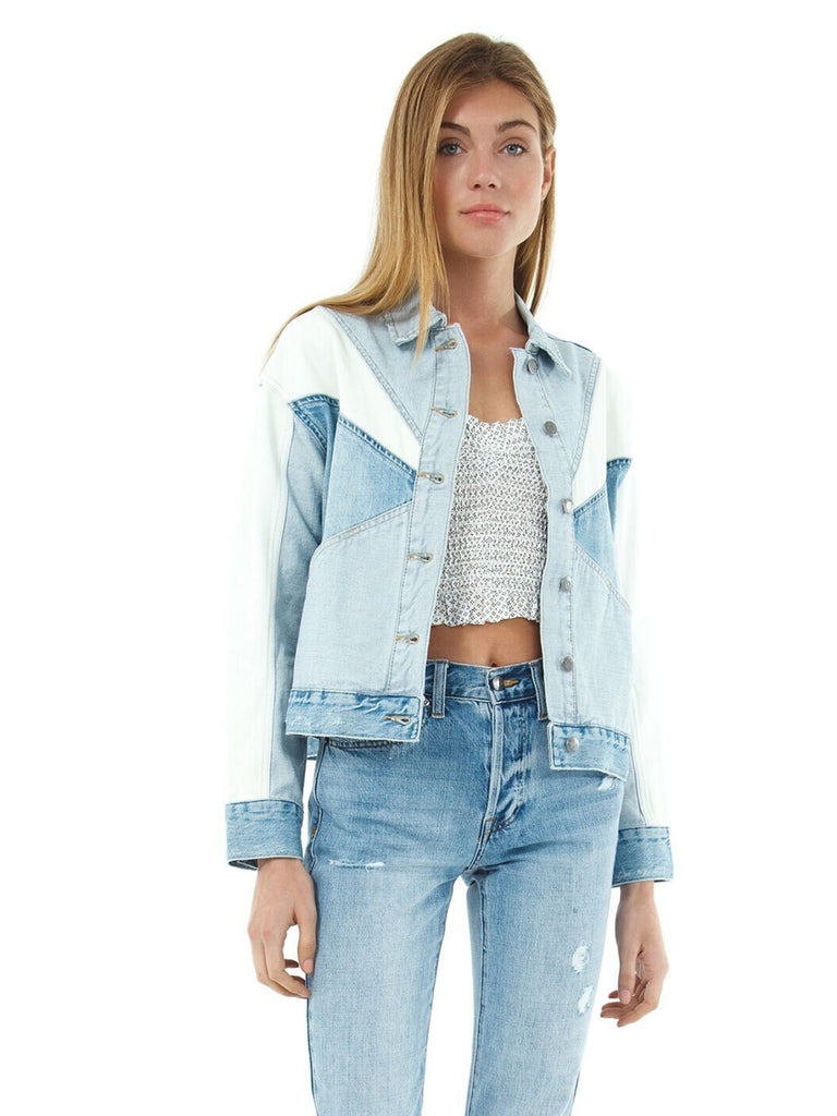 Woman wearing a jacket rental from PISTOLA called Naya Cropped Boyfriend Denim Jacket