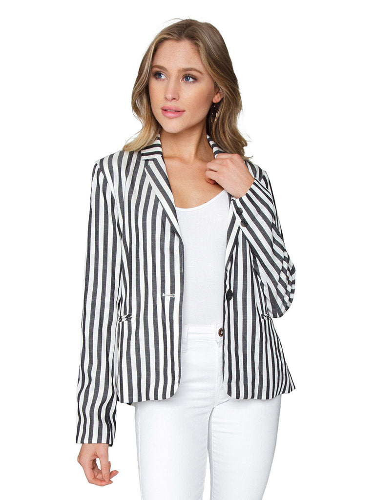 Women outfit in a blazer rental from Cupcakes and Cashmere called Elle Linen Blazer