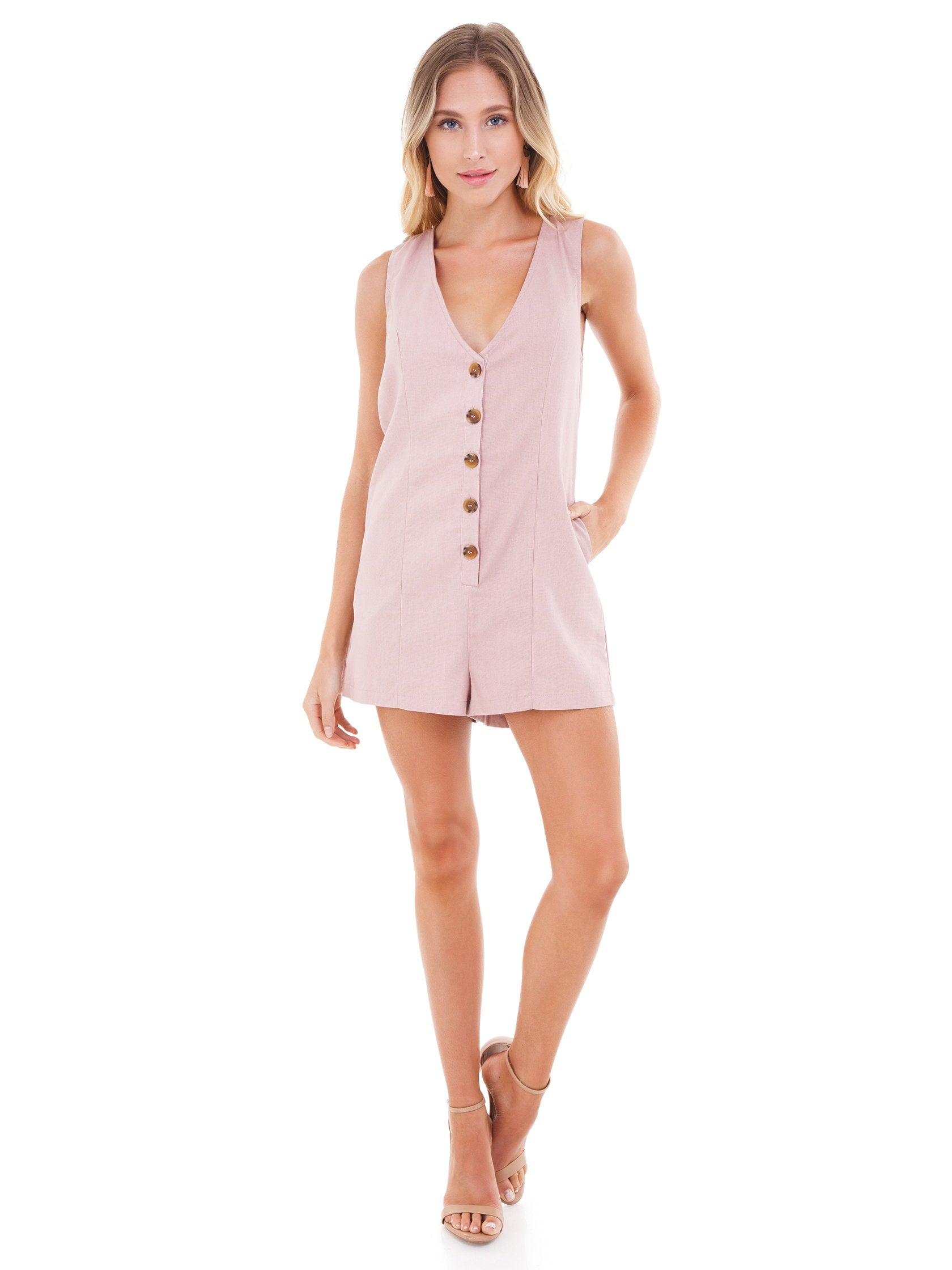 Girl outfit in a romper rental from FashionPass called Woven Button Down Romper