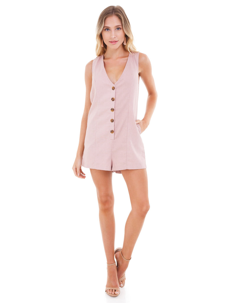 Woman wearing a romper rental from FashionPass called Cadie Overall