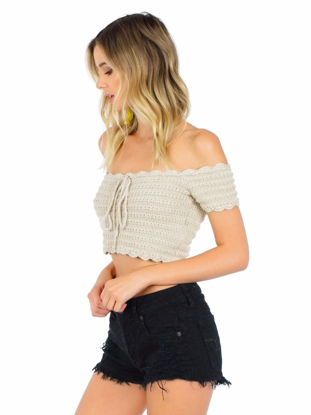 Women wearing a top rental from WYLDR called Break The Rules Crochet Crop Top