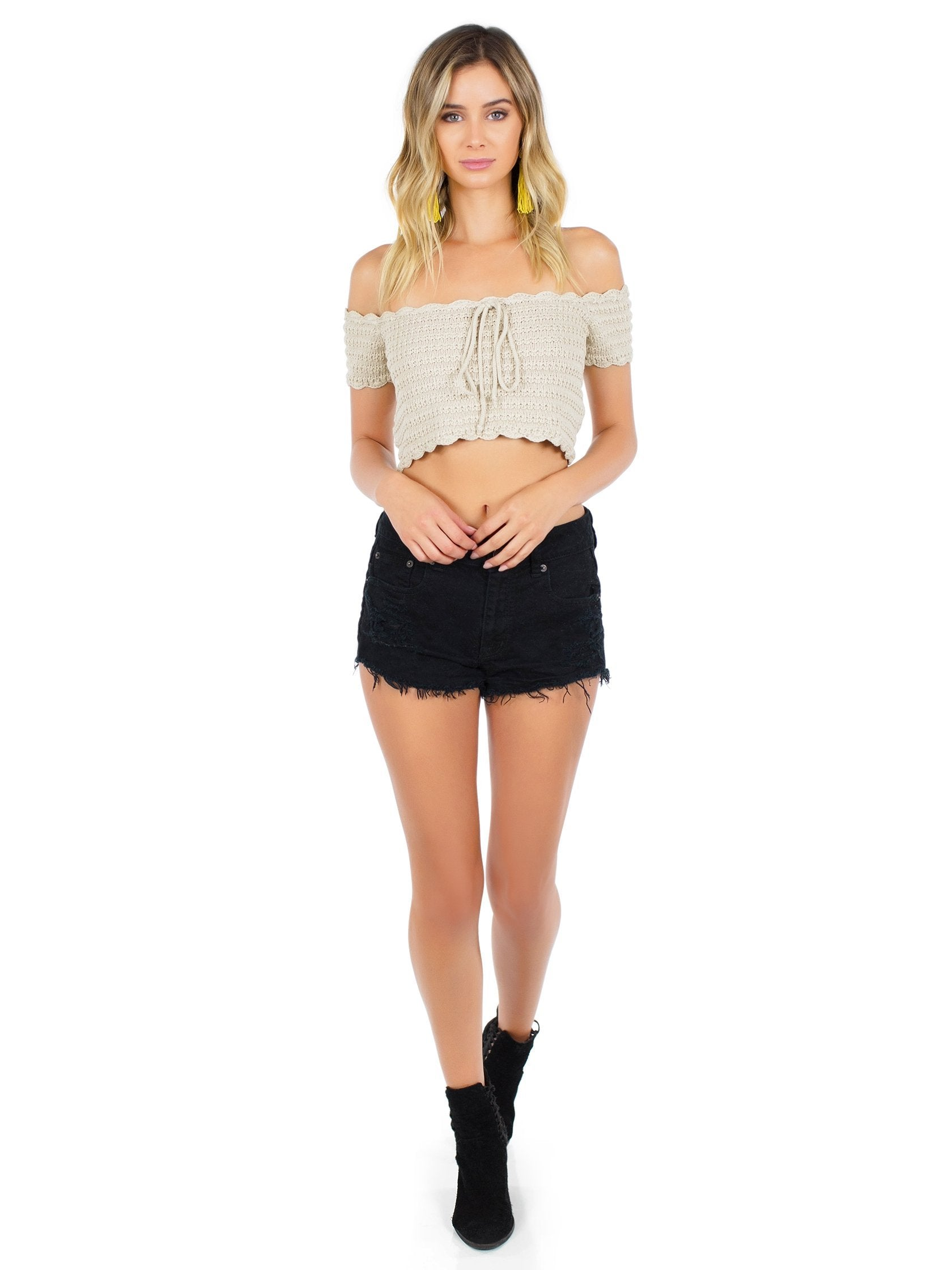 Girl wearing a top rental from WYLDR called Break The Rules Crochet Crop Top