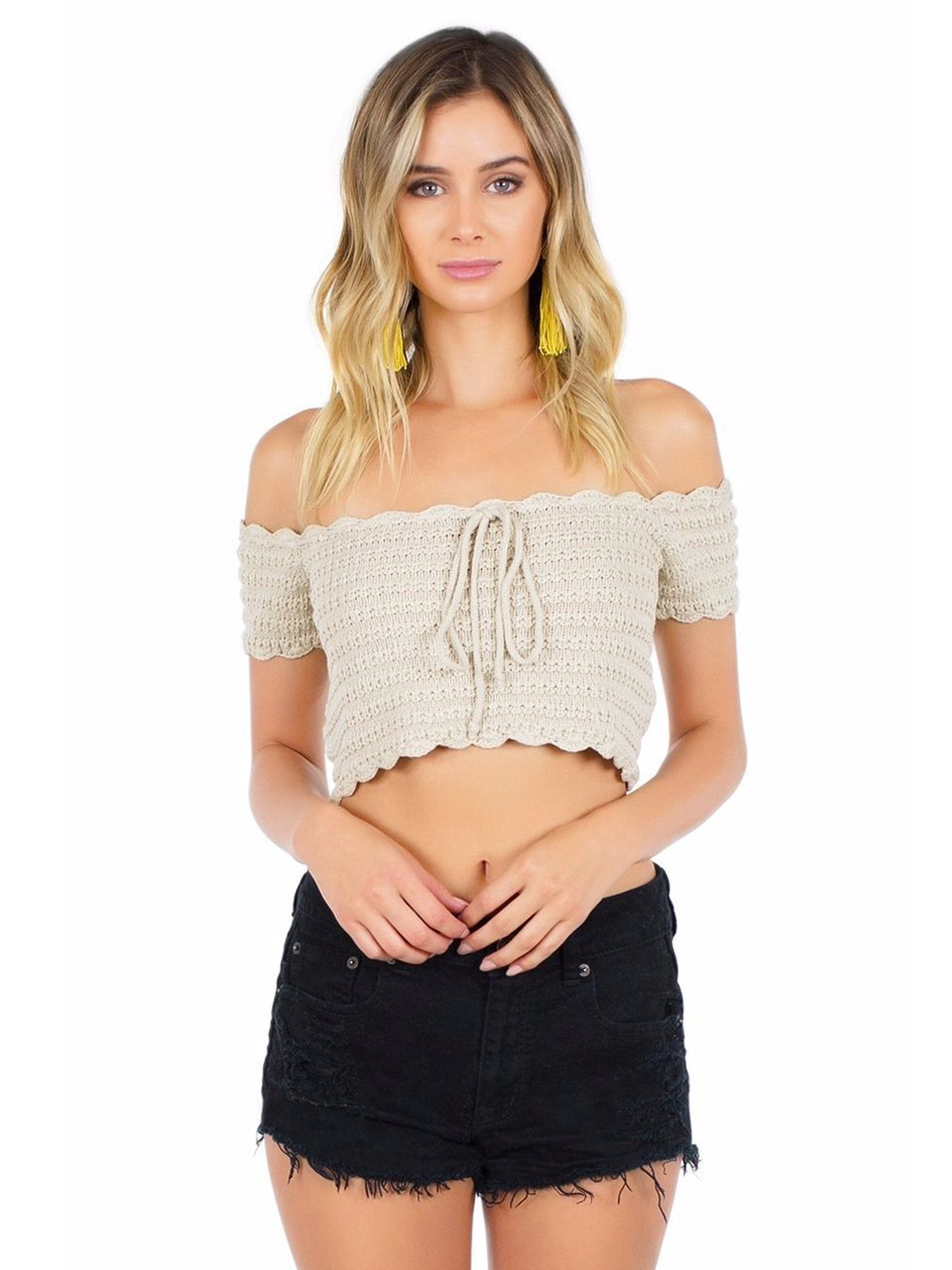 Woman wearing a top rental from WYLDR called Break The Rules Crochet Crop Top