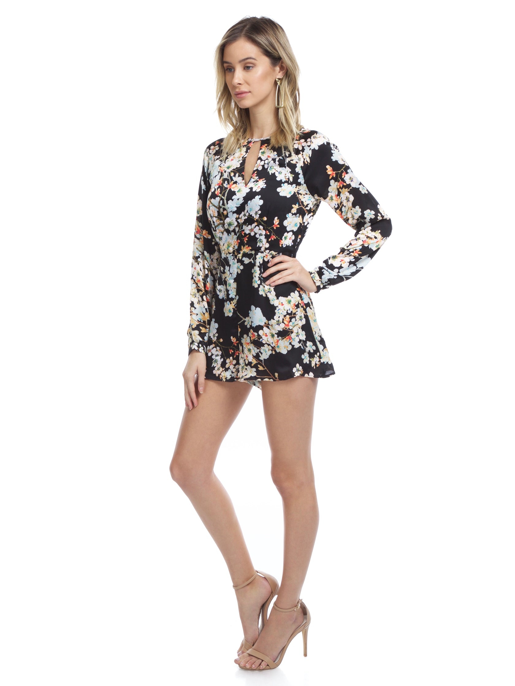 Woman wearing a romper rental from WYLDR called Double Trouble Playsuit
