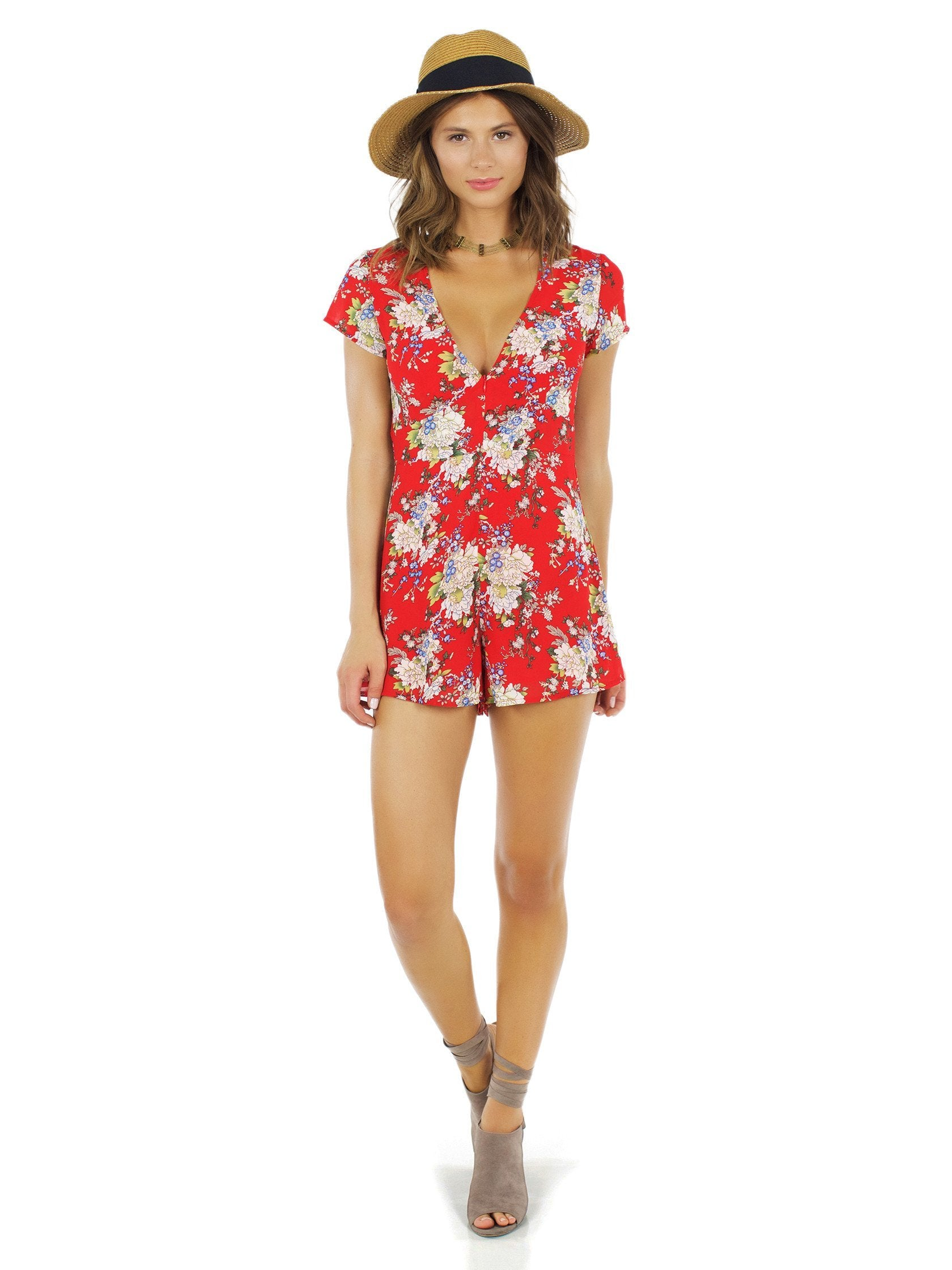 Woman wearing a romper rental from WYLDR called Feel It All Playsuit