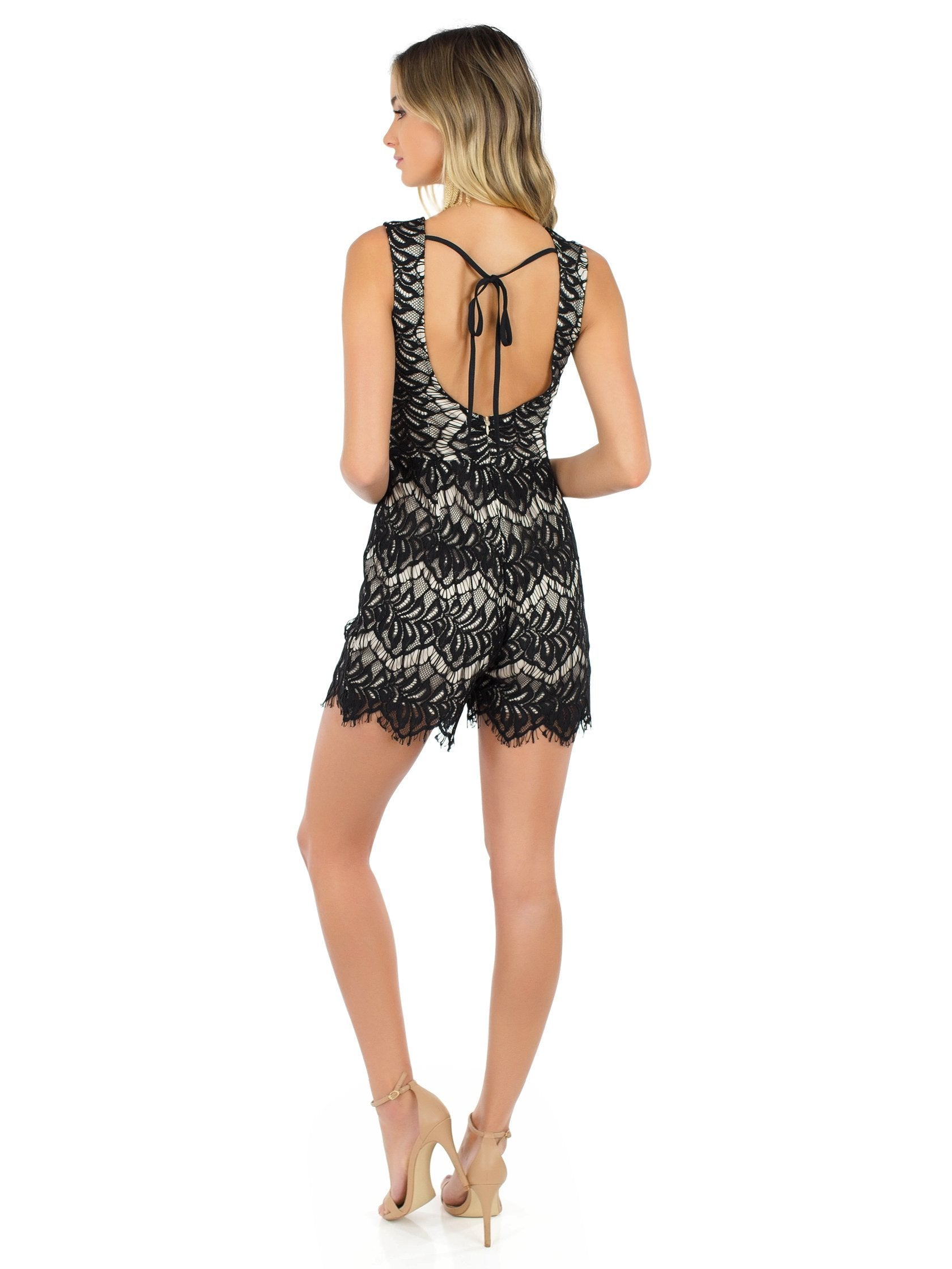 Women wearing a romper rental from WYLDR called Get Up Playsuit