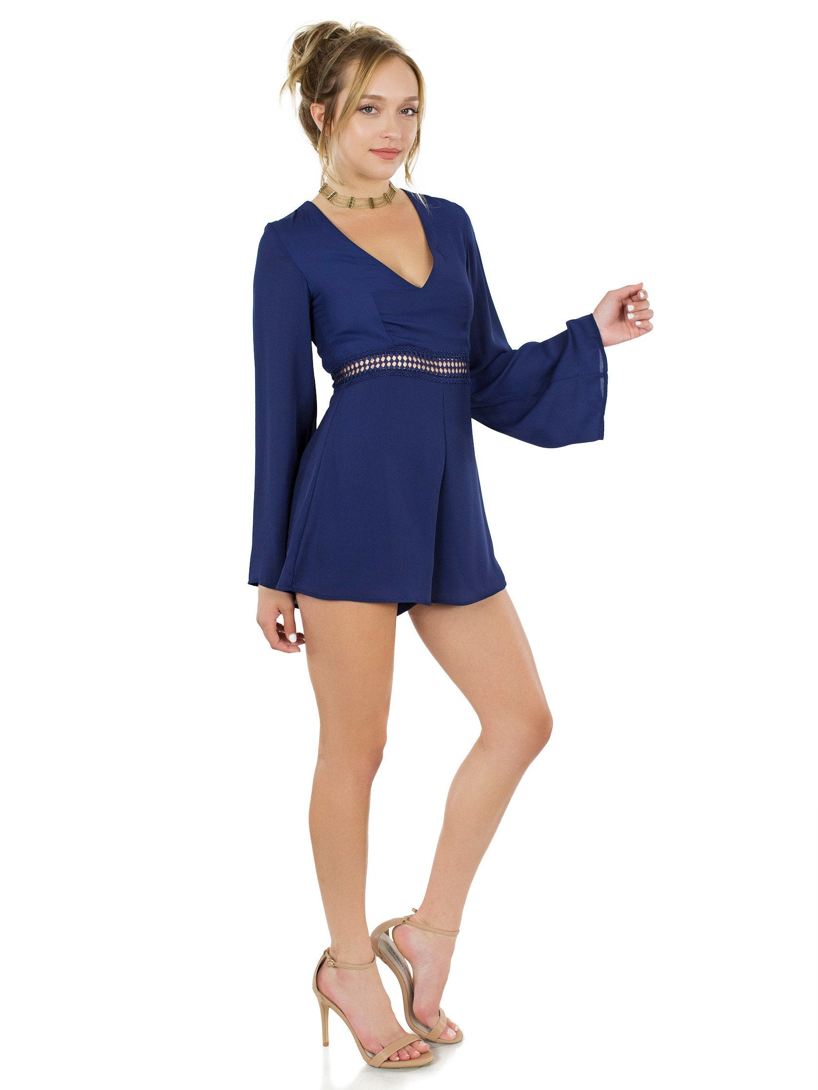 Woman wearing a romper rental from WYLDR called Hope So Romper