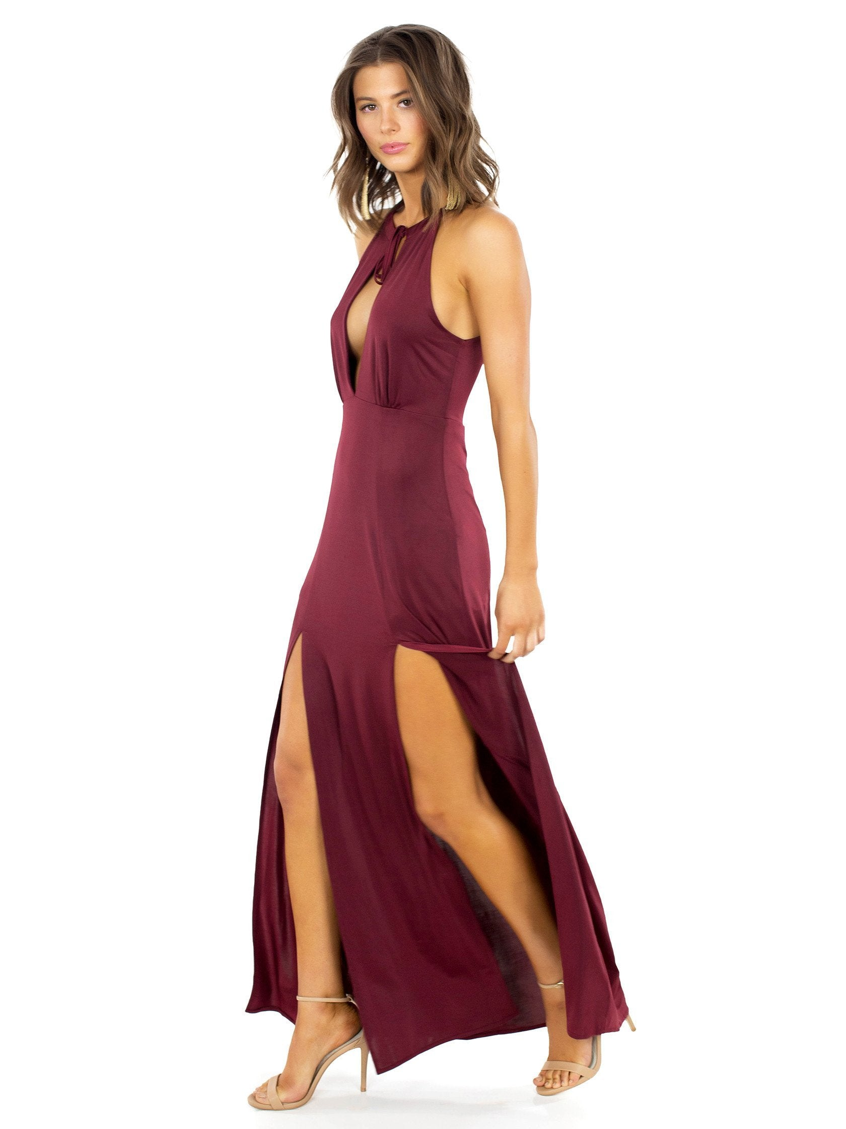 Woman wearing a dress rental from WYLDR called Out Of My League Maxi Dress