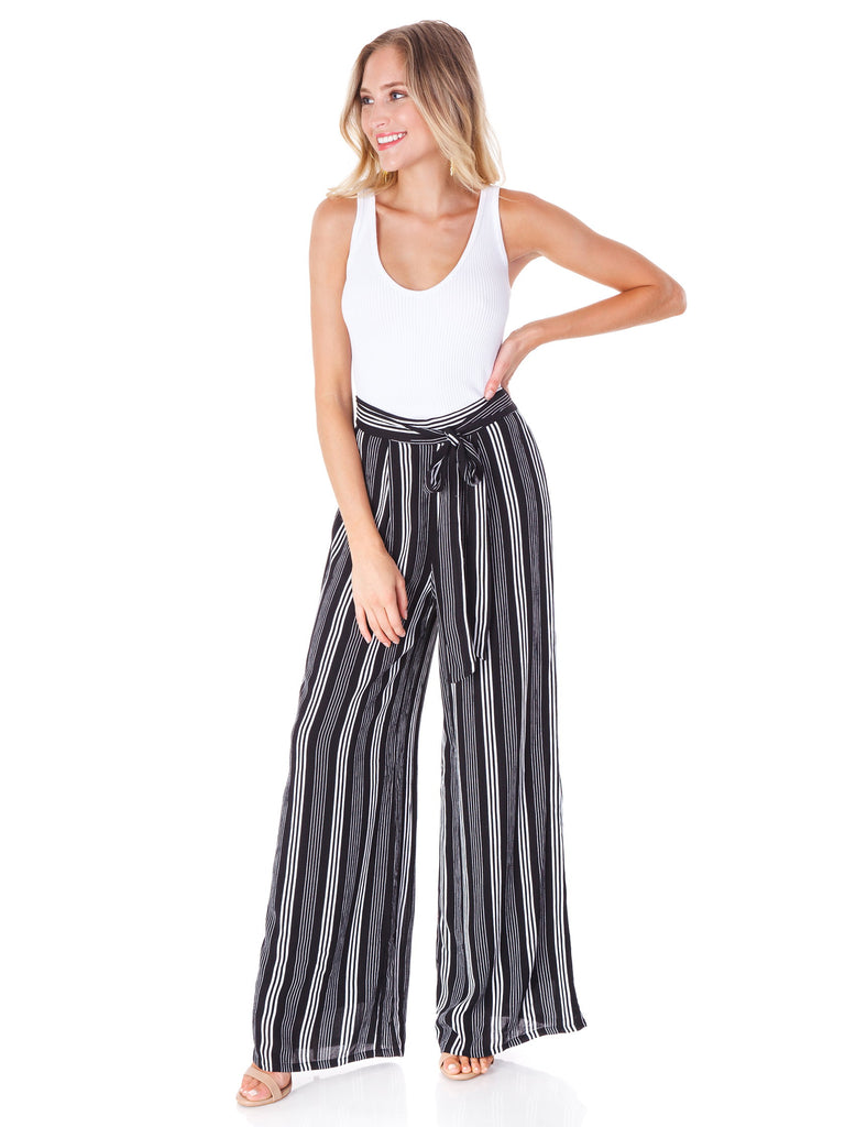 Women wearing a pants rental from Sadie & Sage called Xena Tie Waist Stripe Pants