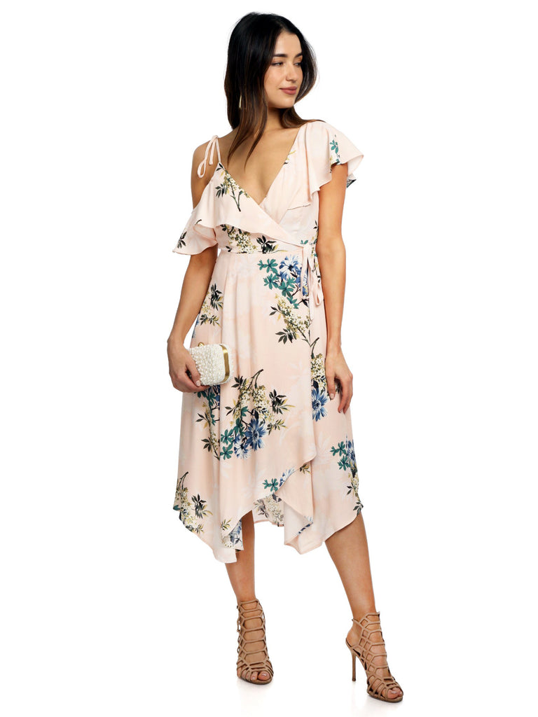 Women wearing a dress rental from ASTR called Carmen Maxi Dress