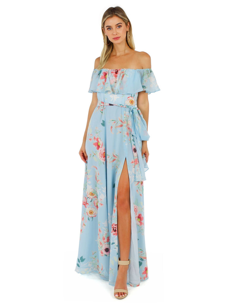 Woman wearing a dress rental from YUMI KIM called Perfect Plunge Maxi Dress