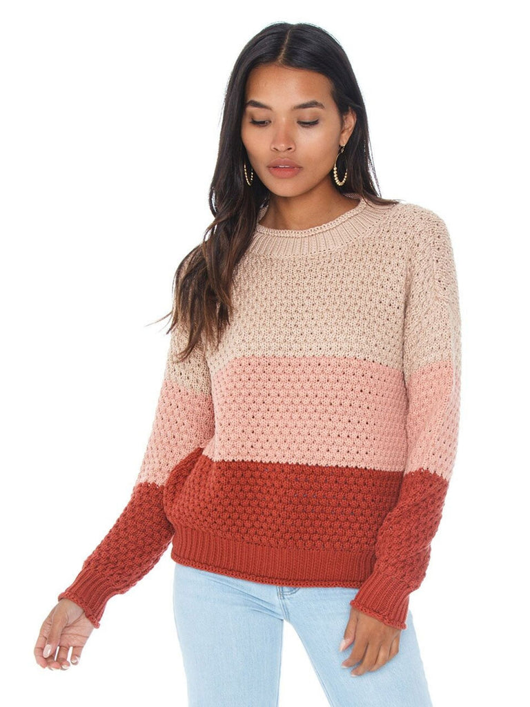 Woman wearing a sweater rental from Knot Sisters called Say It To Me Bodysuit