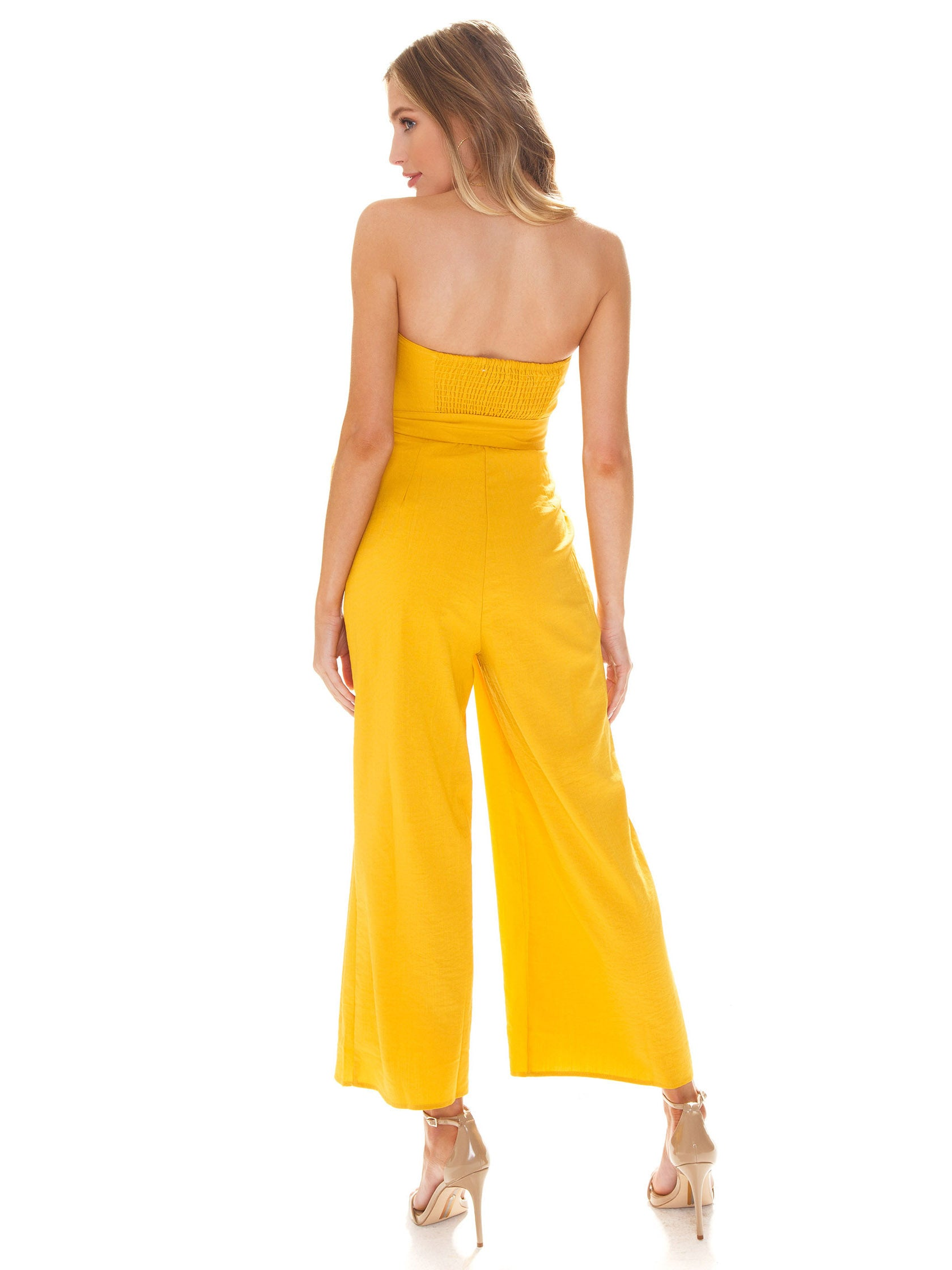 Women wearing a jumpsuit rental from ASTR called Zion Jumpsuit