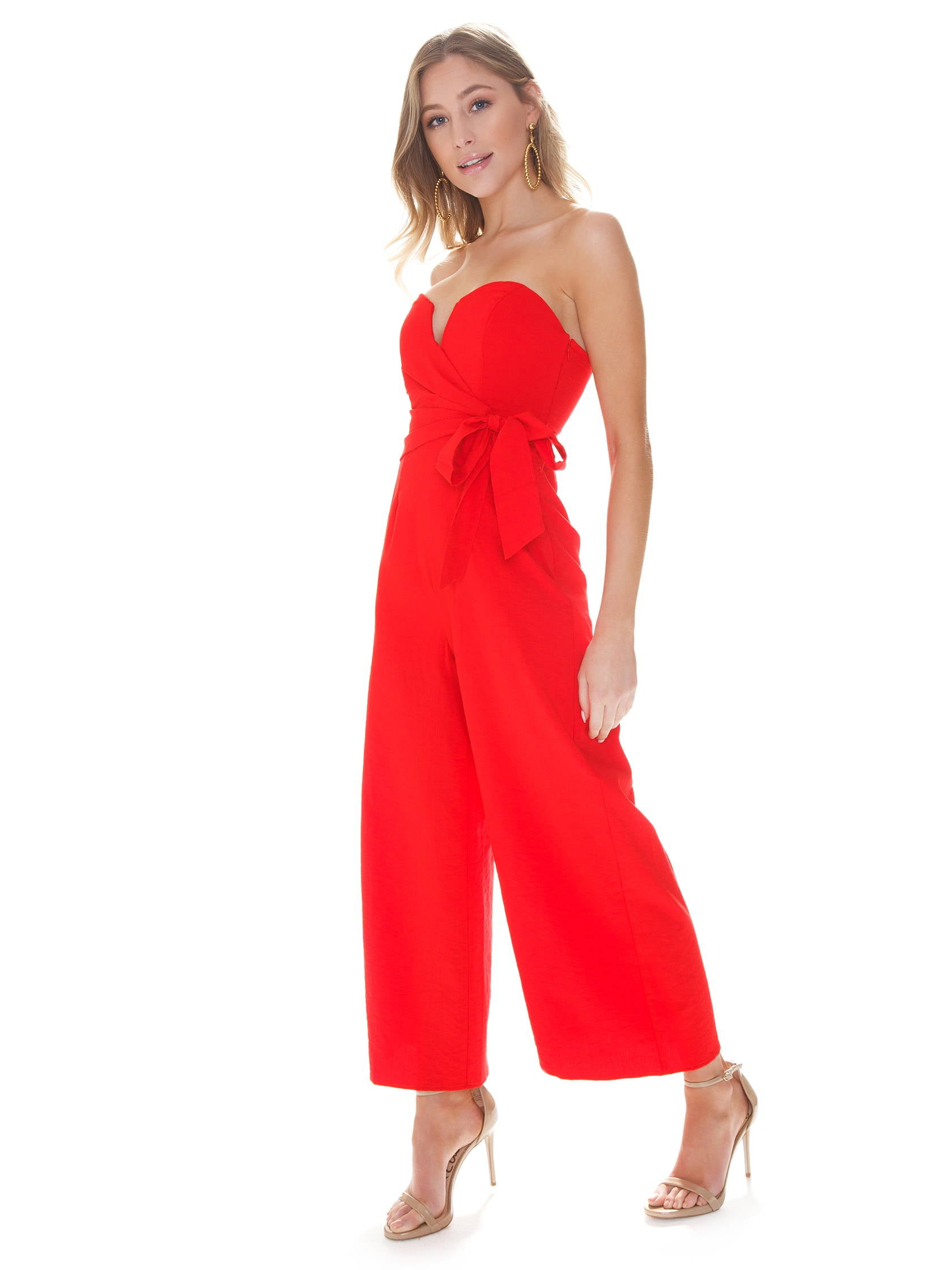 Woman wearing a jumpsuit rental from ASTR called Zion Jumpsuit