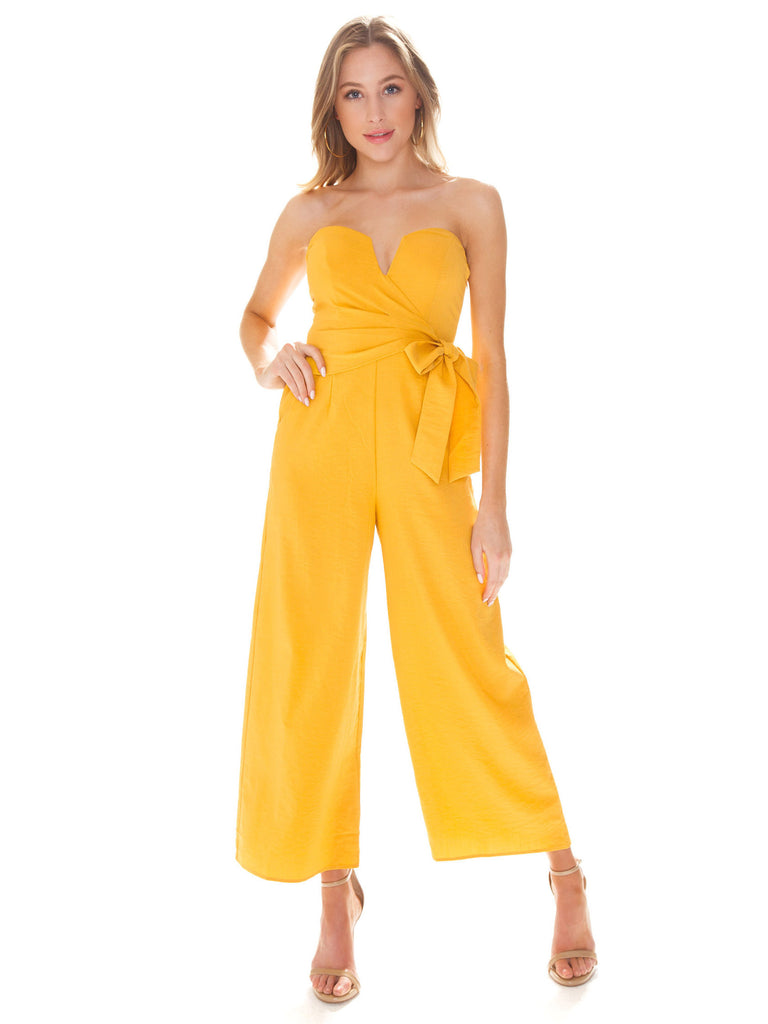 Woman wearing a jumpsuit rental from ASTR called Remi Jumper