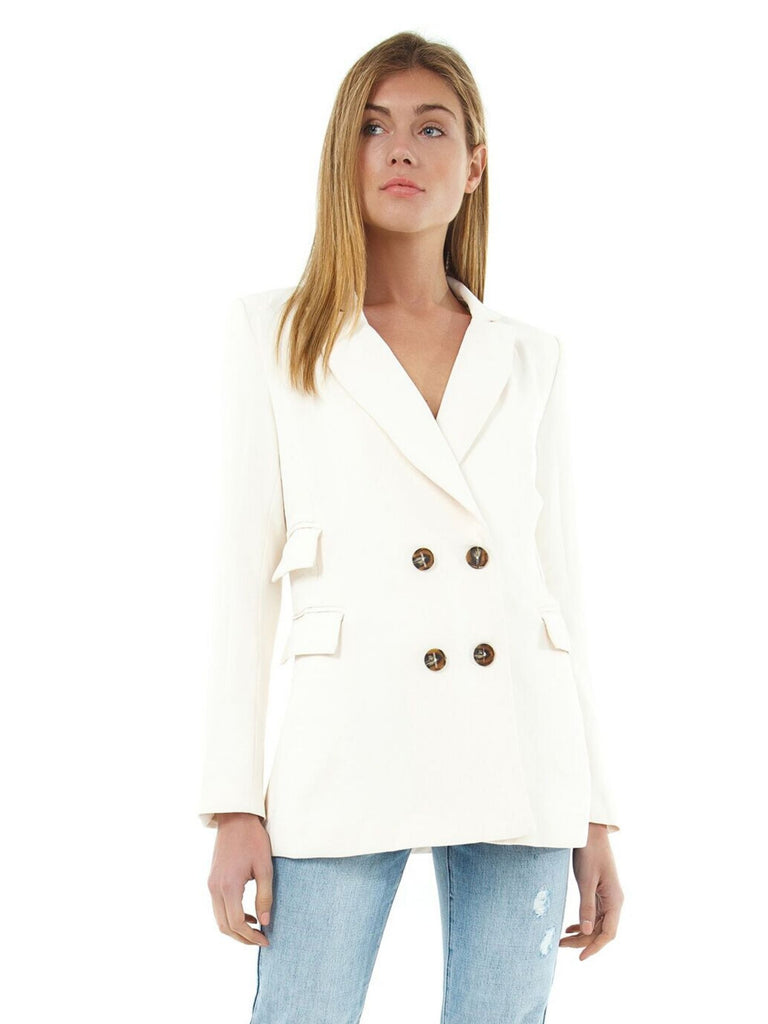 Girl wearing a blazer rental from ASTR called Kensington Coat