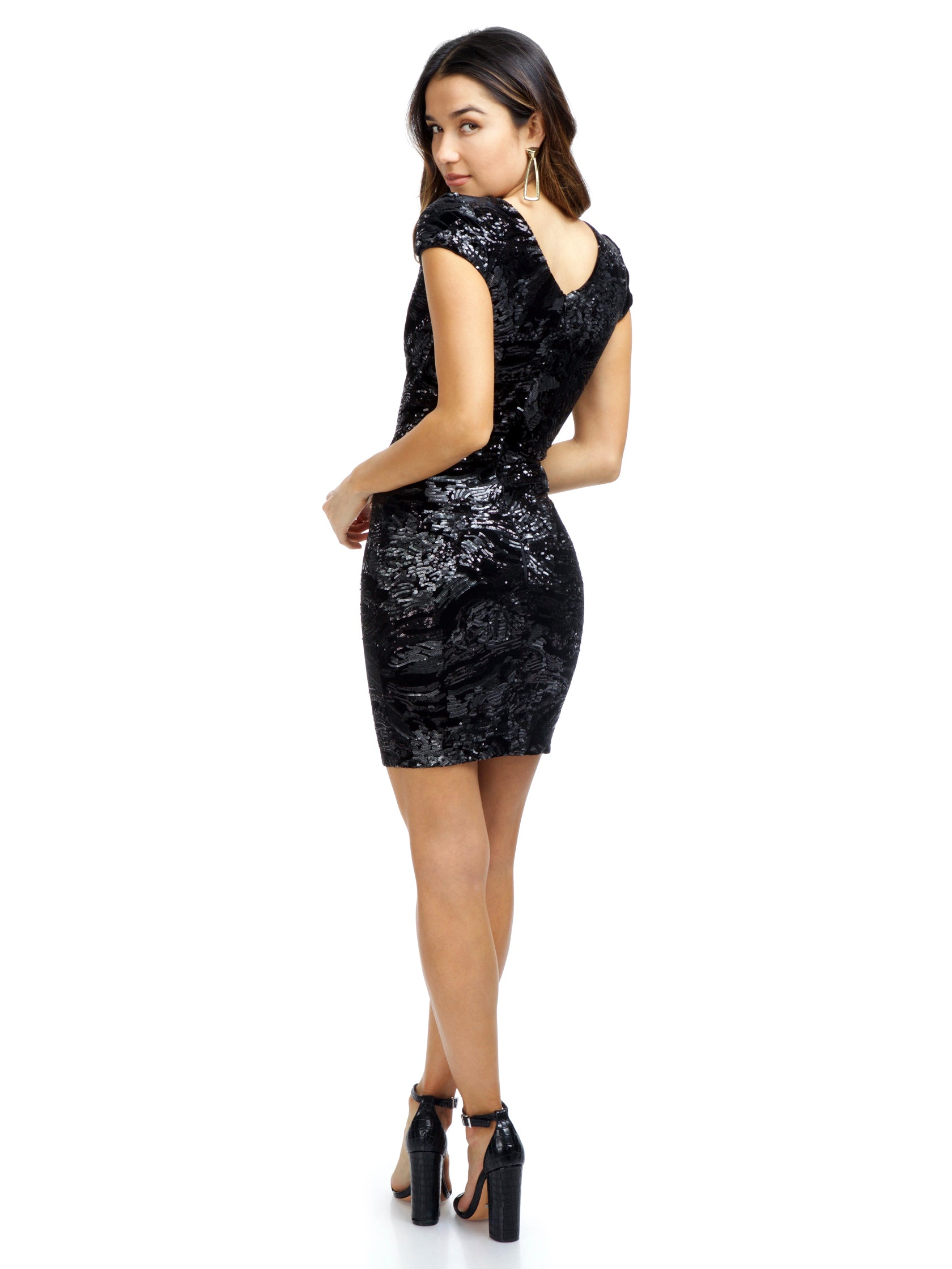 Women wearing a dress rental from Dress the Population called Zoe Sequin Mini Dress