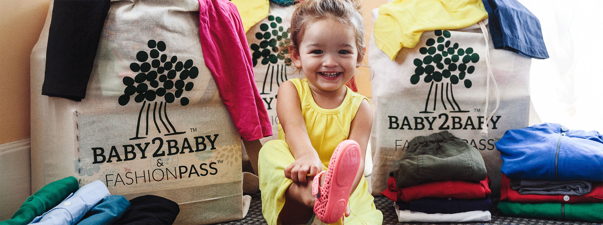 Girl wearing FashionPass sponsored Baby2Baby clothing dress donation