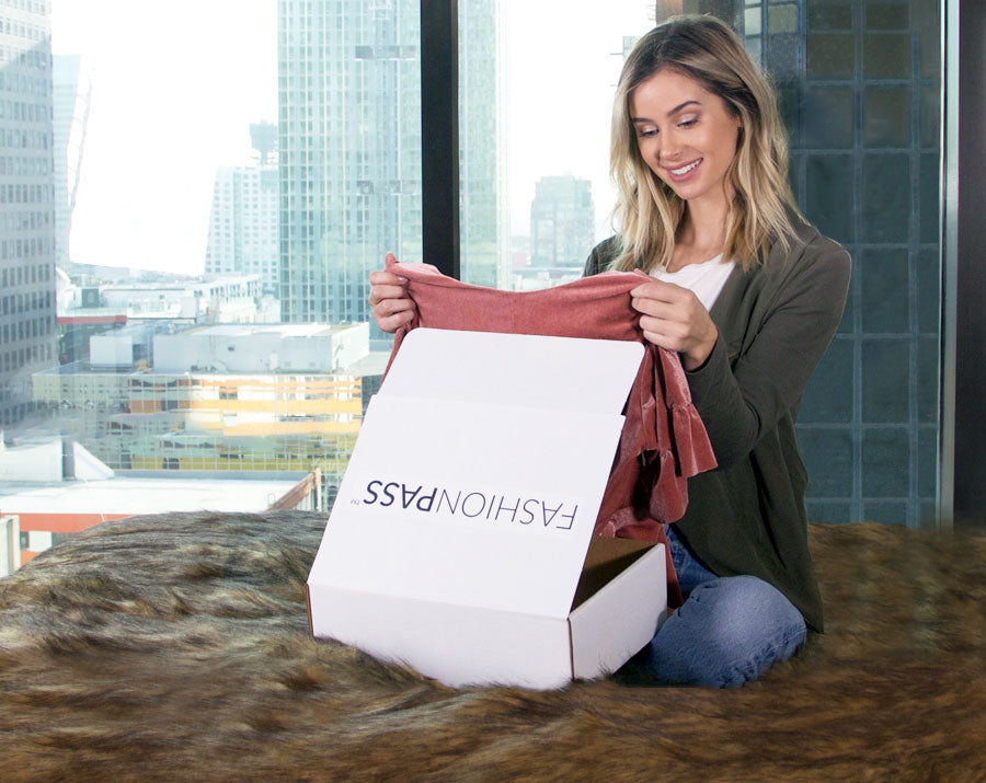Woman opening her fashionpass clothing subscription box
