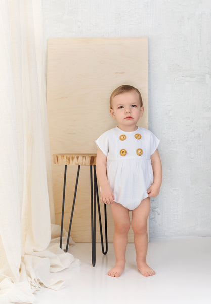 Ivory Muslin Romper with Wooden Button Detail
