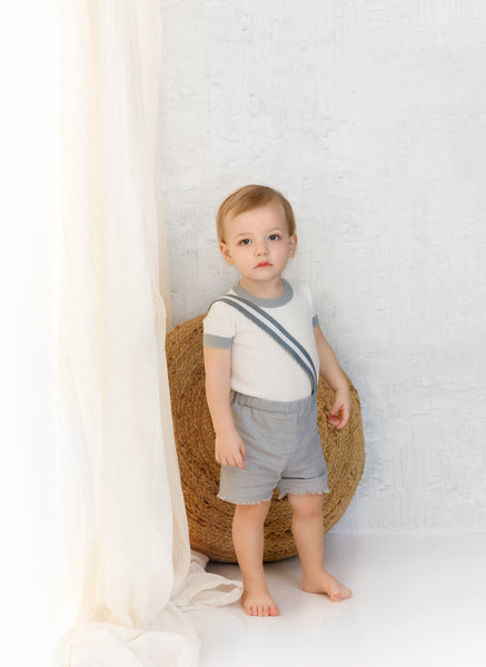 Ivory Ribbed Onesie with Dusty Blue Colored Trimming