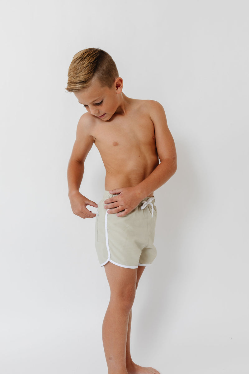 boys tan boardie with side binding