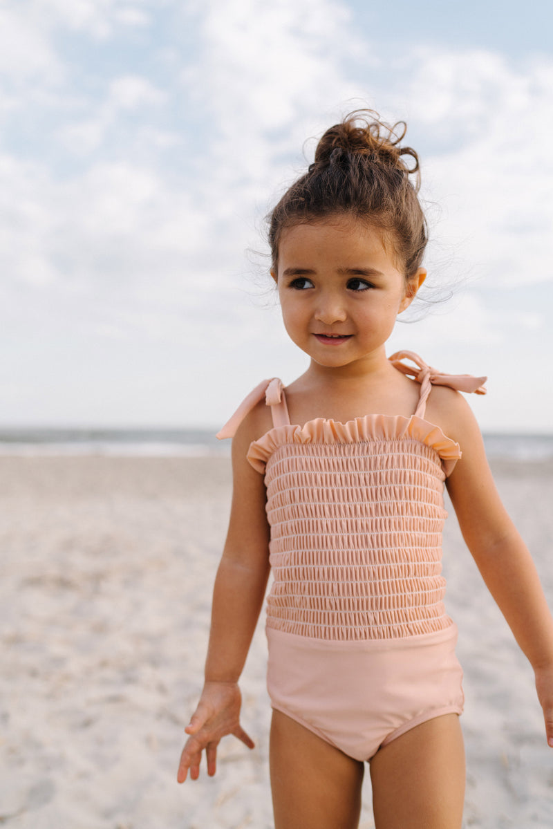 girls shell pink smocked one piece