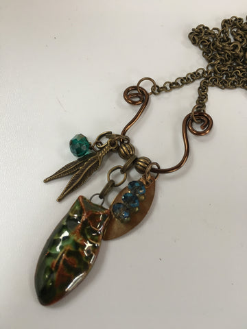 brass charm necklace/05 pottery barn owl and indian feather