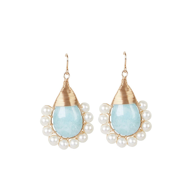 Beck Jewels - Our Aquamarine Lolitas are handcrafted in Brooklyn, by women for women. This piece is one of Beck designer Rebecca's favorite pieces, because its her birthstone (March) and because its beautiful, soothing energy (learn more on the gemstone guide). This special 'Lolita' earring is created pairing freshwater pearls with natural aquamarine gemstones, weaving 14k gold-filled wires (all metals are manufactured in the USA).