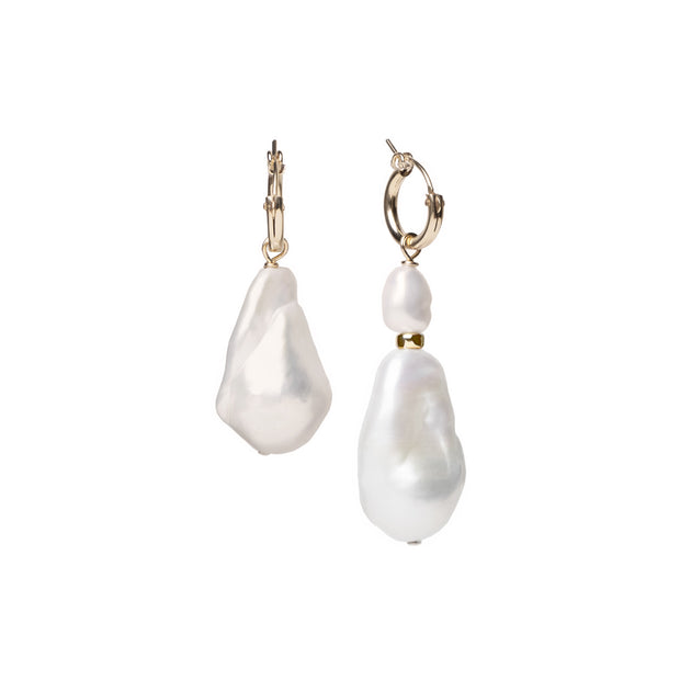 Beck Jewels - Baroque Arcilla hoops are handcrafted in Brooklyn, by women for women. Pairing mismatched natural Baroque pearls on 14k gold-filled hoops.