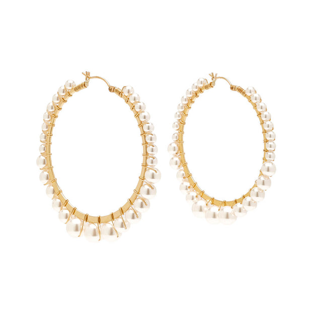 Beck Jewels - Bella hoops are handcrafted in Brooklyn, by women for women.  Swarovski crystal pearls are hand-woven on 14k gold-filled hoops (metals are manufactured in the USA, hoops manufactured in Italy)