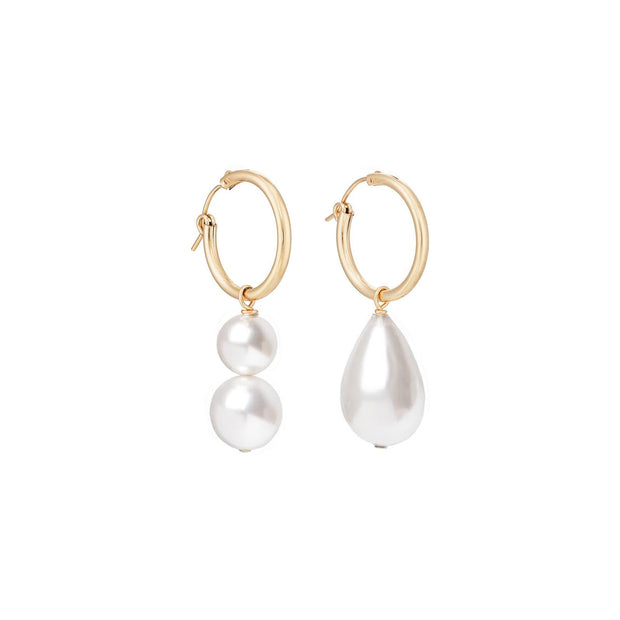 Beck Jewels - Our Best-selling Arcilla hoops are handcrafted in Brooklyn, by women for women. Pairing Swarovski crystal pearls on 14k gold-filled hoops (metals are manufactured in the USA, hoops manufactured in Italy)