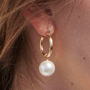 Beck Jewels - Pearl Agra hoops are handcrafted in Brooklyn, by women for women. Pairing two matching Swarovski crystal pearls on 14k gold-filled hoops (metals are manufactured in the USA, hoops manufactured in Italy)