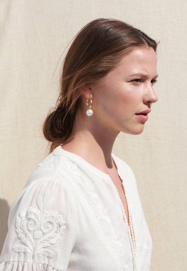 Beck Jewels - Pearl Agra hoops are handcrafted in Brooklyn, by women for women. Pairing two matching Swarovski crystal pearls on 14k gold-filled hoops (metals are manufactured in the USA, hoops manufactured in Italy)  Edit alt text