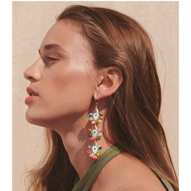 Beck Jewels - Evil Eyes are handcrafted in Brooklyn, by women for women. Pairing millefiori beads with hand-painted mother of pearl evil eyes, created weaving 14k gold-filled wires (metals are manufactured in the USA)