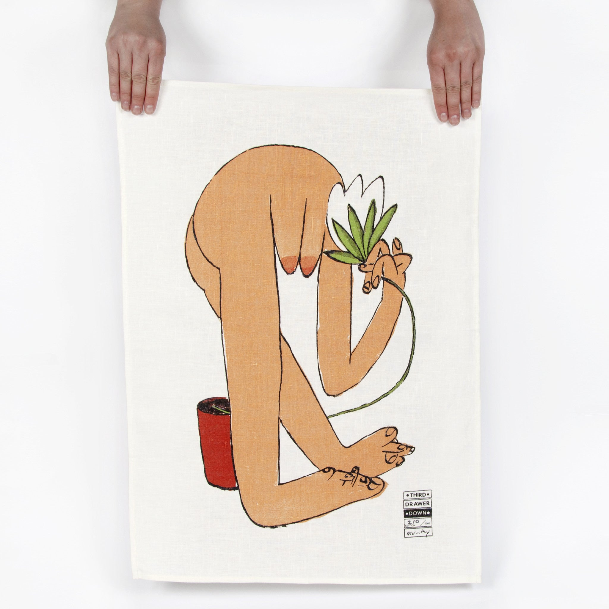 Woman Smelling Flower Tea Towel Image