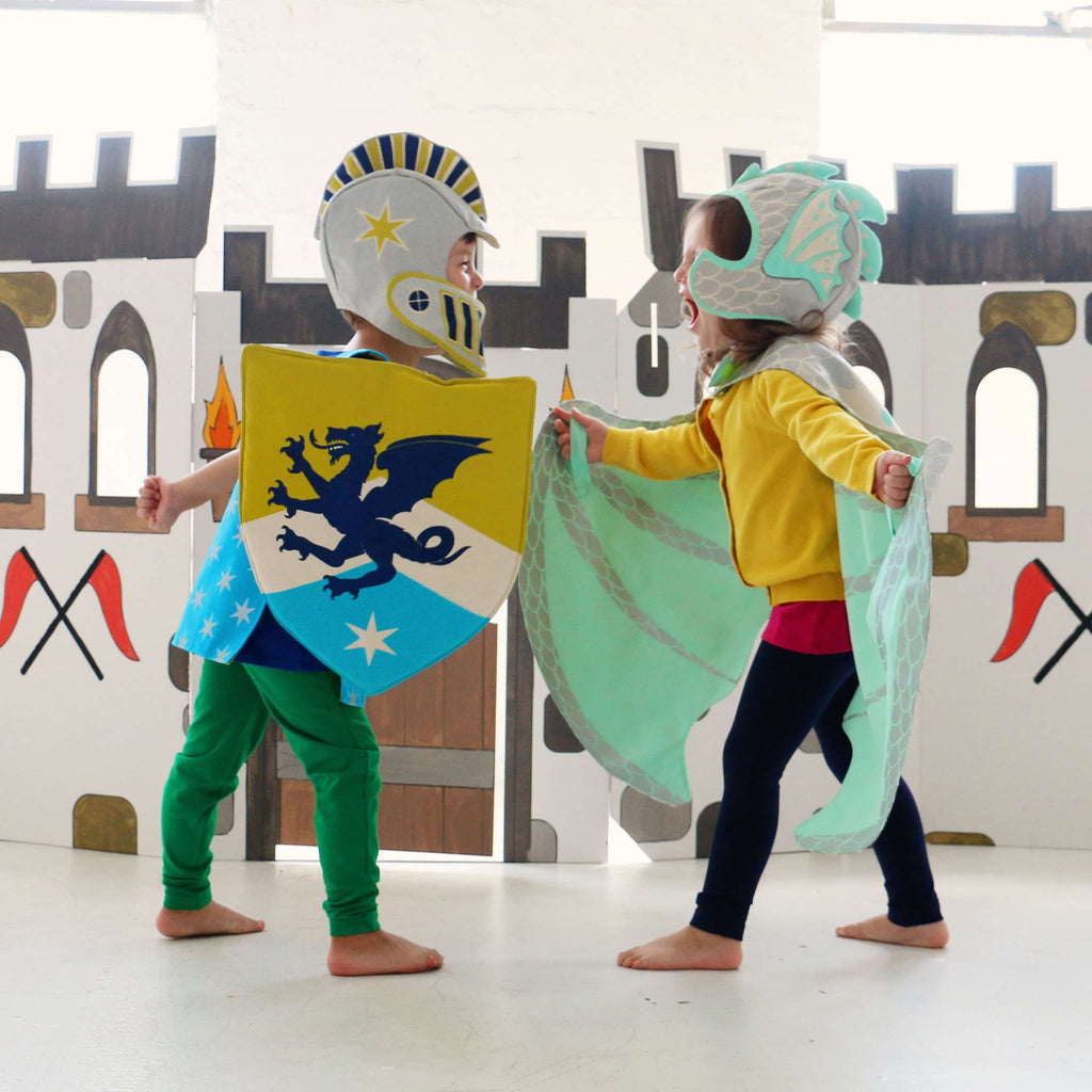 children playing costumes knight dragon lovelane designs
