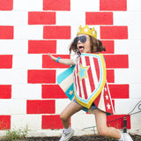 Child in action wearing superhero costume red stripes