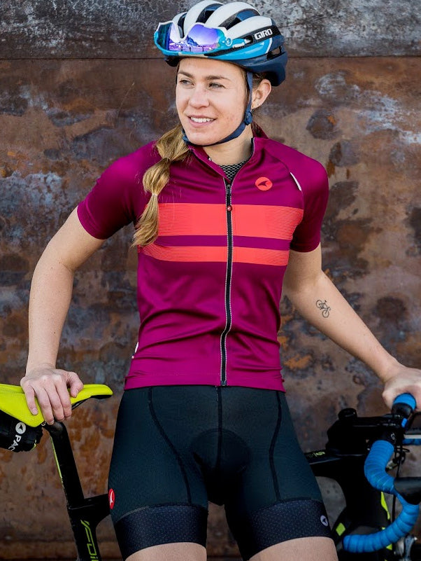 Woman cyclist wearing a purple Storm+ Jersey