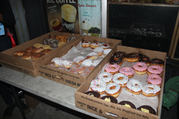 Ariana Reichler - A smorgasbord of donuts from Alpha Donuts in Queens. Coffee was also available at all stops.