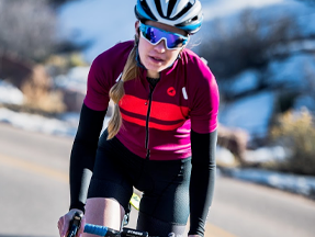 Womam wearing the Storm+ Jersey while riding uphill