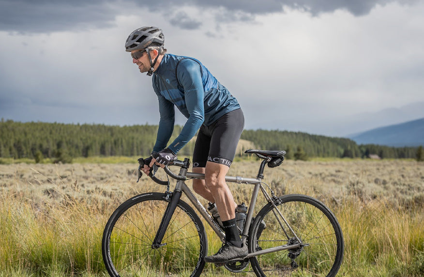 Fall Cycling Clothing Collection - male cyclist in long sleeve blue jersey.