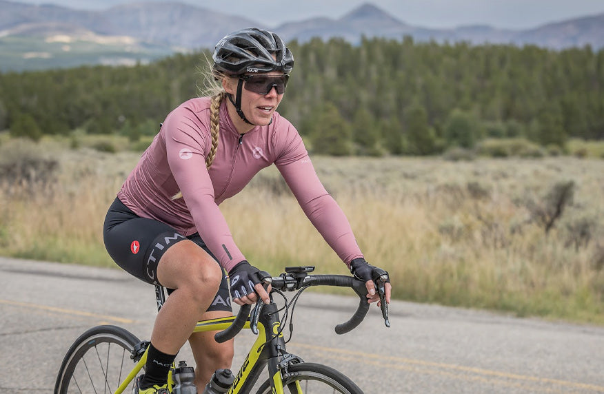 Female cyclist wearing Dusty Rose long sleeve cycling jersey