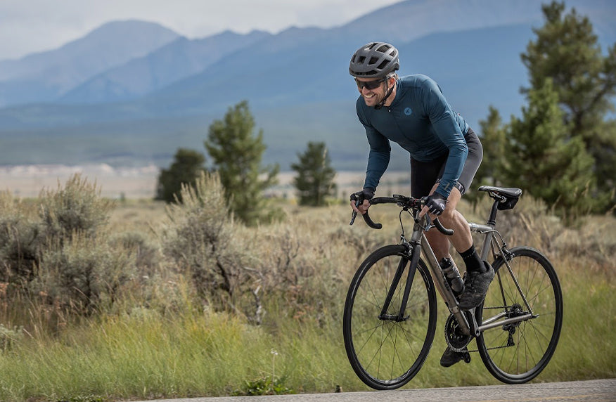 Fall Colors - male cyclist wearing blue long sleeve cycling jersey and vest