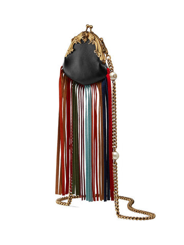 "A leather purse with a cascade of multicolored suede fringe. An intricately carved metal trim along the frame closure features the feline head detail-a motif synonymous with the house. Completed with a detachable chain strap with cream resin pearls. Black leather. Multicolor suede fringe. Antique gold-toned hardware. Carved metal frame with feline head. Detachable chain shoulder strap with cream resin pearls and 19.5"" drop. Kiss lock closure. 4.5""W x 3.5""H. Rose print silk lining. Made in Italy. Delivered i"