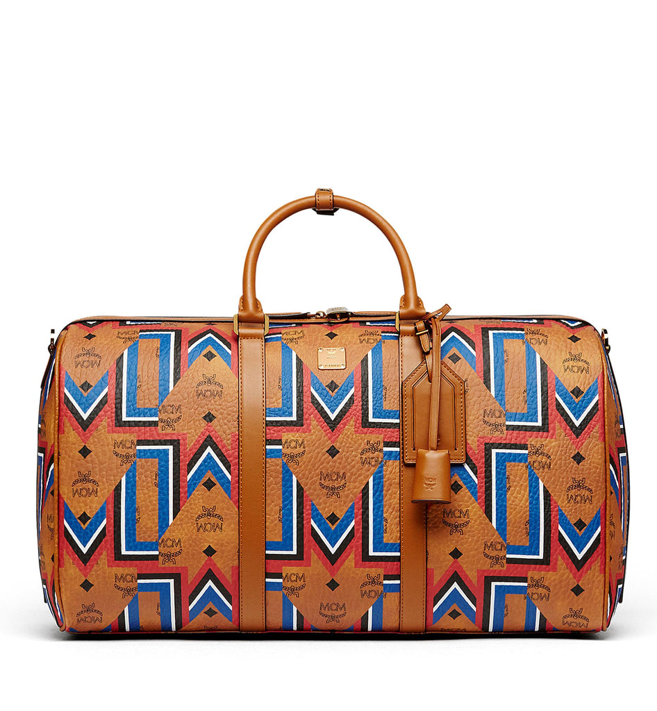 MCM STARK GUNTA WEEKENDER DUFFLE BAG ACCESSORIES | LuxurySnob: pre owned luxury handbags, authentic designer goods second hand, second hand luxury bags, gently used designer shoes