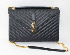 SAINT LAURENT LARGE ENVELOPE GRAIN DE POUDRE CHAIN BAG HANDBAGS | LuxurySnob: pre owned luxury handbags, authentic designer goods second hand, second hand luxury bags, gently used designer shoes