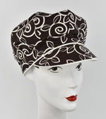 Brown cap with ivory swirls design