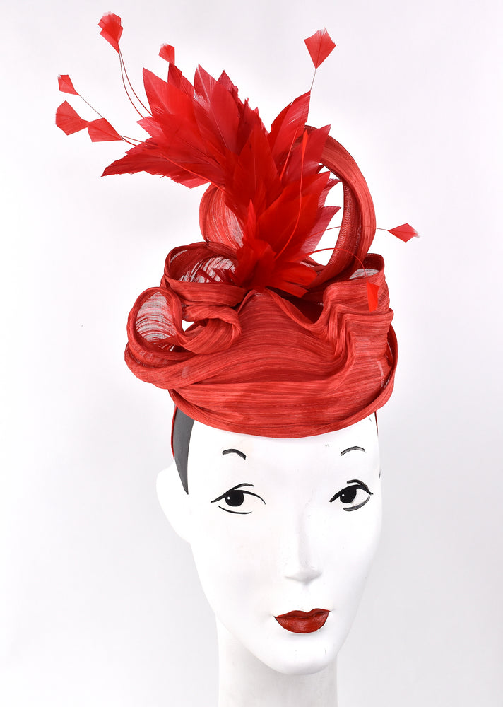 Red sculpted headpiece with red flowers