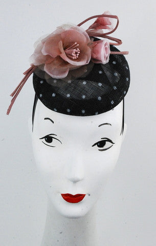 Black and white  spotted sinamay beret is  styled with a rose coloured silk flower